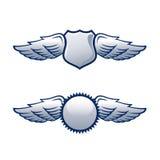 Schilden met vleugels Royalty-vrije Stock Foto's