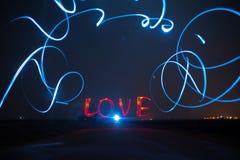 Schilder de Liefde in dark royalty-vrije stock fotografie