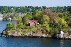 Schilderachtige huizen op de eilanden Stock Afbeeldingen