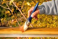 Schilderend hout Stock Foto's