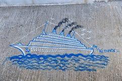 Schilderend op een straat in Kythnos-eiland, Cycladen, Griekenland stock foto's