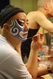 Schilderende blauwe maskers Stock Foto