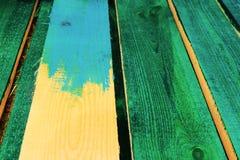 Schilderende houten raad stock foto