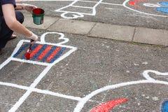 schilderende speelplaats stock foto's