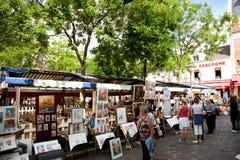 Schilderijen in Tertre Vierkant, Parijs Stock Foto's