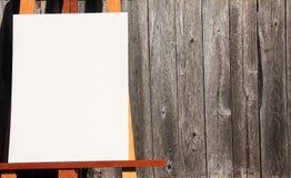 Schildersezel en hout stock afbeelding