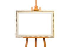 Schildersezel met het schilderen van kader Stock Afbeelding