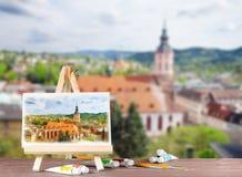 Schildersezel met waterverf het schilderen met een mening van baden-Baden Royalty-vrije Stock Afbeelding
