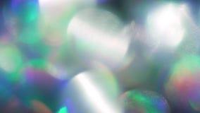 Schillernde holoraphic Folie des futuristischen Hintergrundes, Mischung von mehrfarbigen Partikeln stock footage