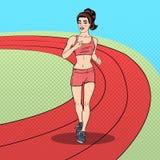 Schiocco adatto Art Woman Running dei giovani sullo stadio Immagini Stock