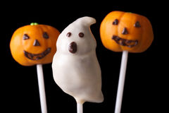 Schiocco del dolce di Halloween spettrale e zucche sul nero Fotografie Stock Libere da Diritti
