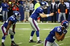 Schiocco di attese del Giants Eli Manning dei cowboy Immagini Stock