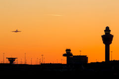 Amsterdam Schiphol airport control tower with an orange sunset Stock Photography