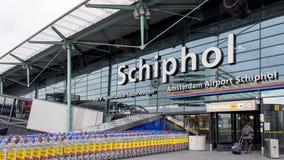 Schiphol Amsterdam luchthaveningang stock afbeeldingen