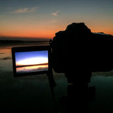 Schirmkamera, die ein Reservoirphoto macht Lizenzfreie Stockbilder