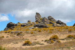 Schist rock formations Nevis Road, New Zealand Stock Photos