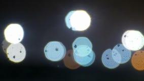 Schitter bokeh kleurenlichten defocused achtergrond stock video