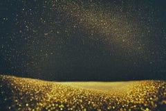 Schitter uitstekende lichtenachtergrond Goud en zwarte Geconcentreerd DE stock foto's
