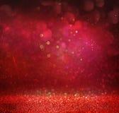 Schitter uitstekende lichtenachtergrond goud, rood en purple defocused Royalty-vrije Stock Afbeelding