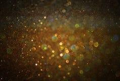 Schitter uitstekende lichtenachtergrond lichte goud en zwarte Royalty-vrije Stock Afbeeldingen