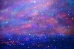 Schitter uitstekende lichtenachtergrond Roze en purple DE-geconcentreerd stock foto's