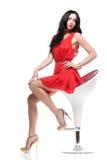 Schitterend brunette op stoel Royalty-vrije Stock Foto's