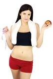 Schitterend sportief meisje met appel en meters ter beschikking Royalty-vrije Stock Foto's