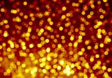 Schittert de goud vage bokeh heldere achtergrond, licht, oranje nacht, geel, cirkels, vlekken, vakantie royalty-vrije illustratie
