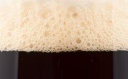 Schiuma della birra, primo piano estremo Immagini Stock