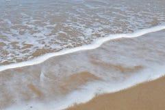 Schiuma nella spiaggia Fotografia Stock