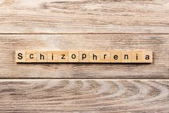 Schizophrenia word written on wood block. schizophrenia text on table, concept royalty free stock photo