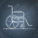 Schizzo della sedia a rotelle sulla lavagna Fotografia Stock
