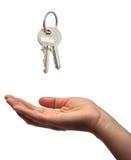 Schlüsselübergabe Stockbild