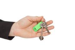 Schlüssel in einer Hand Stockbild