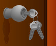 Schlüssel gelassen im Türgriff Stockbilder