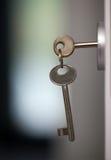Schlüssel im Verschluss Stockbild