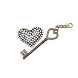 Schlüssel mit dem Herzen als Symbol der Liebe Stockbilder
