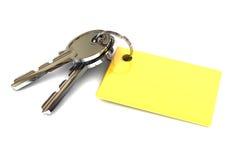 Schlüssel mit leerem Goldschlüsselring Stockfoto