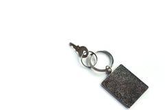 Schlüssel mit Rechteckschlüsselanhänger Stockfotos