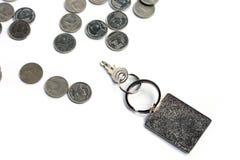 Schlüssel mit Rechteckschlüsselanhänger mit Bad-Münze Stockbilder