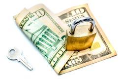 Schlüssel und Vorhängeschloß, die Dollaranmerkung sichern Lizenzfreie Stockbilder