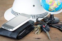 Schlüssel und Weltreisekonzept Stockbild
