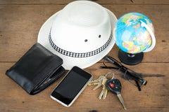 Schlüssel und Weltreisekonzept Stockbilder