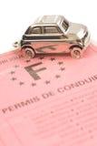 Schlüsselauto mit wenigem Schlüsselring in der Form des Autos Lizenzfreies Stockfoto