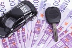 Schlüsselauto und Bargeld Stockfoto