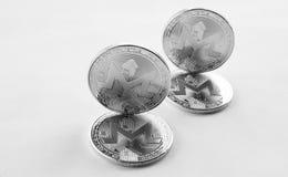 Schlüsselwährung - Silbermünze monero Stockbild