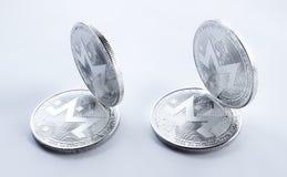 Schlüsselwährungssilber monero auf weißem Hintergrund Stockfotografie