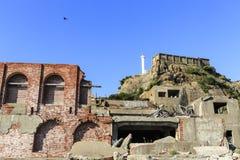 Schlachtschiffinsel und -leuchtturm Lizenzfreies Stockfoto