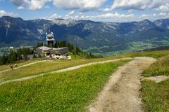 Tourists in front of Planai bike and ski areal in Schladming, Austria Stock Image