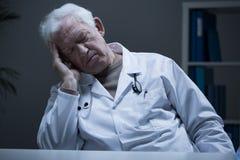 Schlafen bei der Arbeit Stockfoto